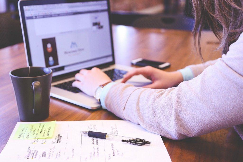 woman browsing her laptop